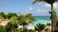 studio-alize-vue-mer-anse-des-rochers-imgh1325778980-vue-piscine.jpg